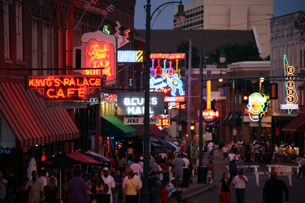 Resturants and Stores on Beale Street at Night with Pedestrian Activity : Stock Photo