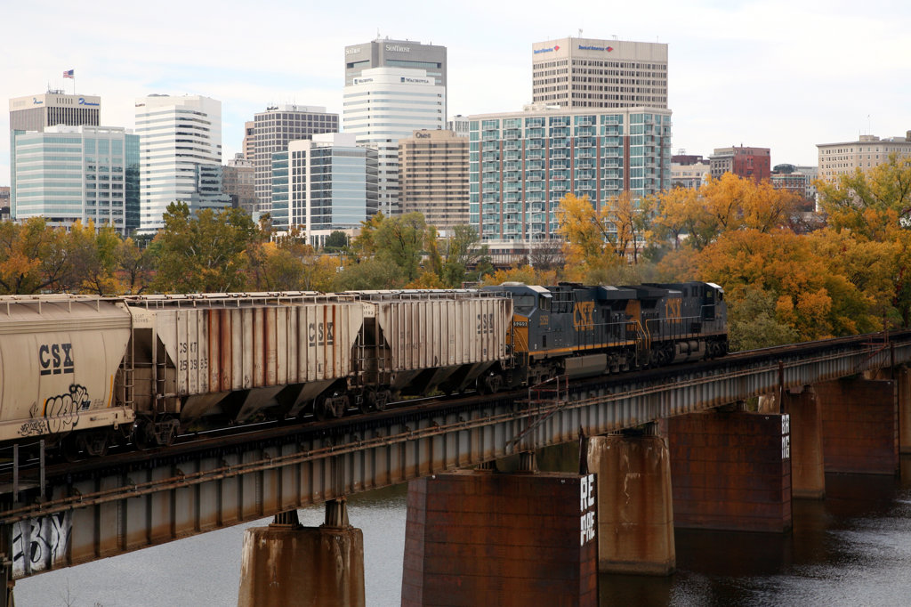 Cargo Train on Bridge over James River with Richmond Skyline in Background : Stock Photo