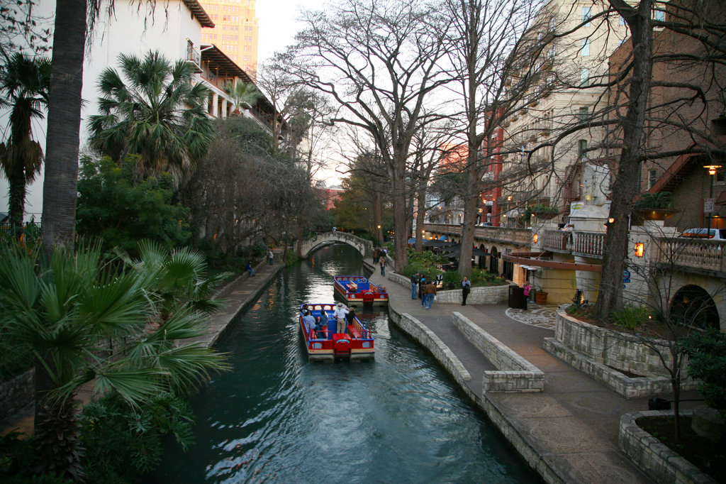 Stock Photo: 4017-2378 Looking Down the San Antonio Riverfront with Rio San Antonio Cruises River Tour Boats on the water and Poeple on the Riverwalk