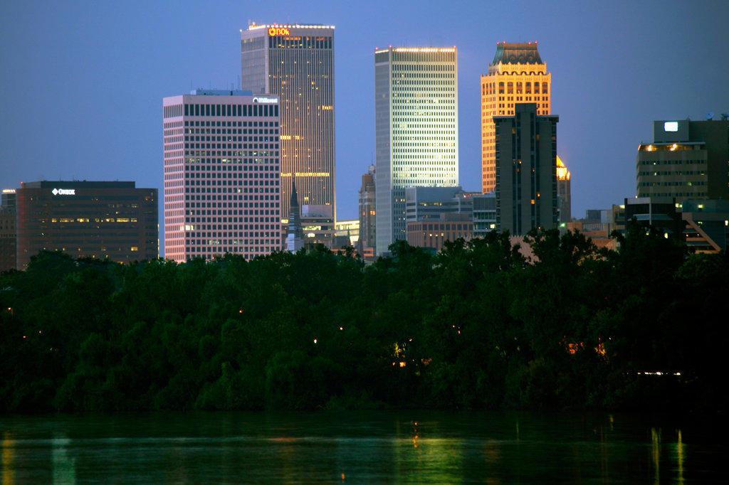 Tulsa, Oklahoma Skyline at Dusk from the Arkansas River : Stock Photo