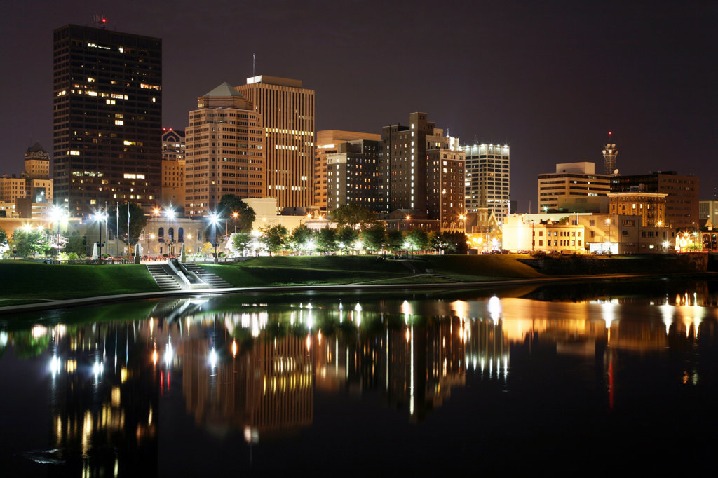 Downtown Dayton along the Great Miami River lit up at night, Ohio, USA : Stock Photo
