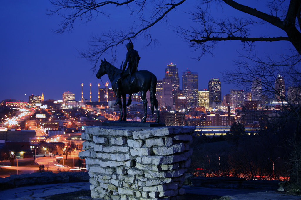 Stock Photo: 4017-2600 The Scout statue in Penn Valley Park overlooking downtown Kansas City at night, Missouri, USA