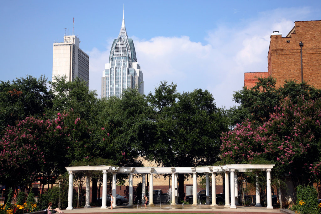 Park with skyscrapers in the background, Bienville Square, RSA Battle House Tower, Mobile, Alabama, USA : Stock Photo