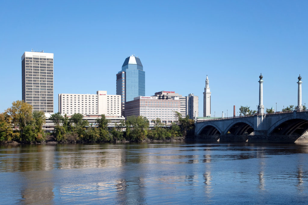 Downtown skyline of Springfield, Massachusetts from across the Connecticut River with the Springfield Memorial Bridge, USA : Stock Photo