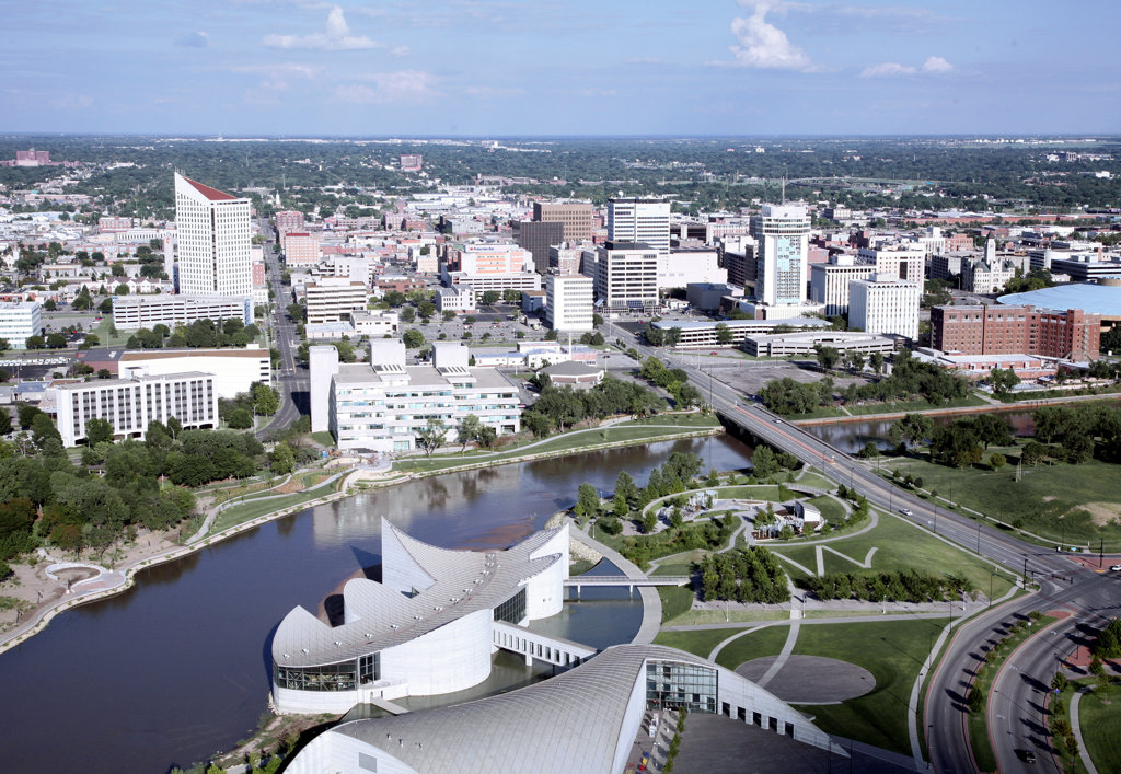 Aerial view of science museum with buildings in a city, Exploration Place, Arkansas River, Wichita, Kansas, USA : Stock Photo