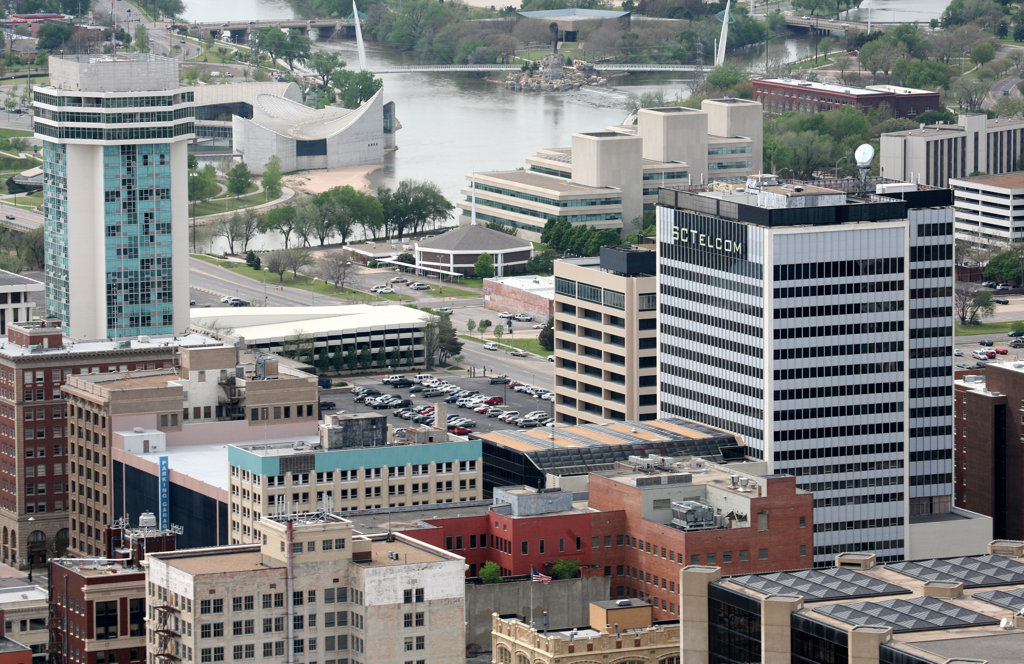Aerial view of buildings with the Arkansas River in the background, Wichita, Kansas, USA : Stock Photo