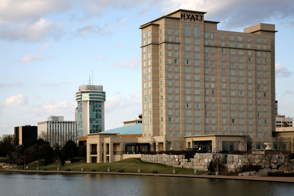 Hotel at the waterfront, Hyatt Regency Hotel, Arkansas River, Wichita, Kansas, USA : Stock Photo