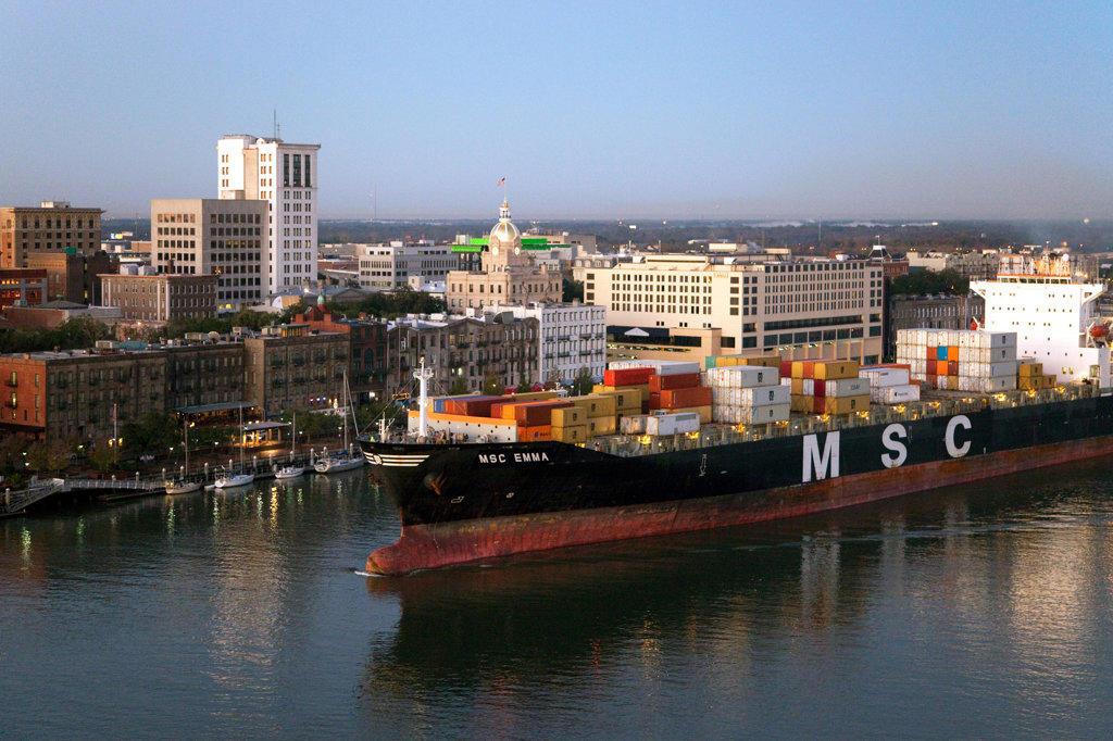 USA, Georgia, Savannah, Container Ship passing through harbor near downtown : Stock Photo