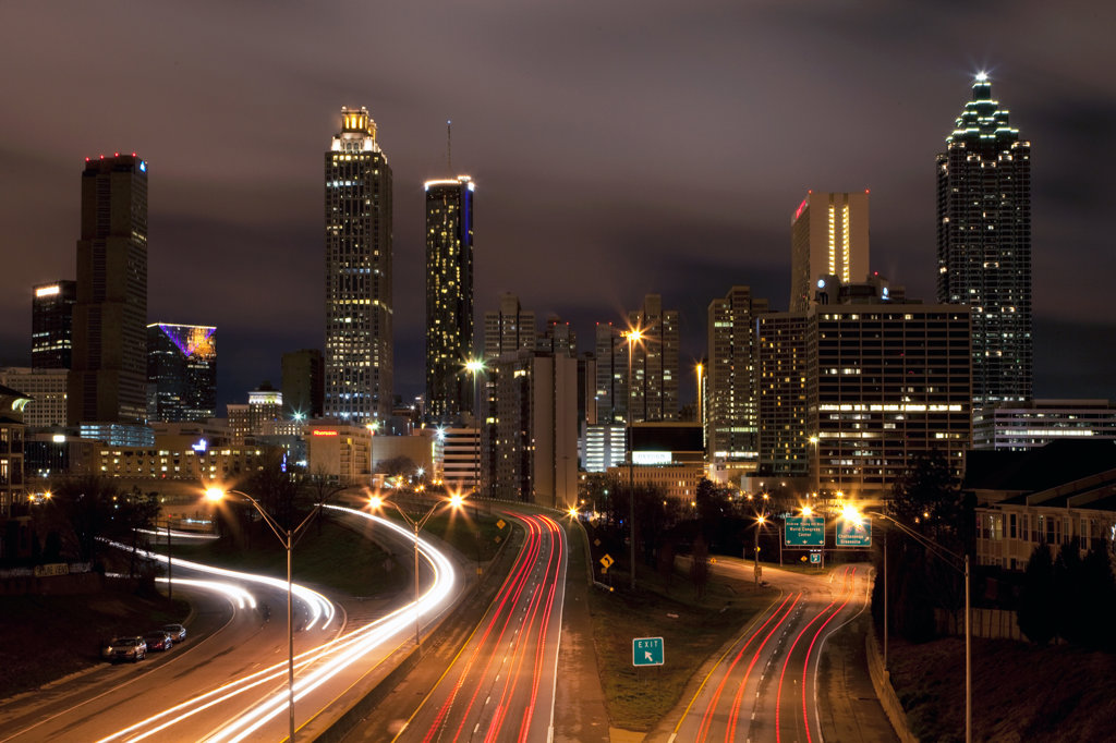 Stock Photo: 4017-3186 Downtown skyline of Atlanta at dusk with traffic streaming along Freedom Parkway, Georgia, USA