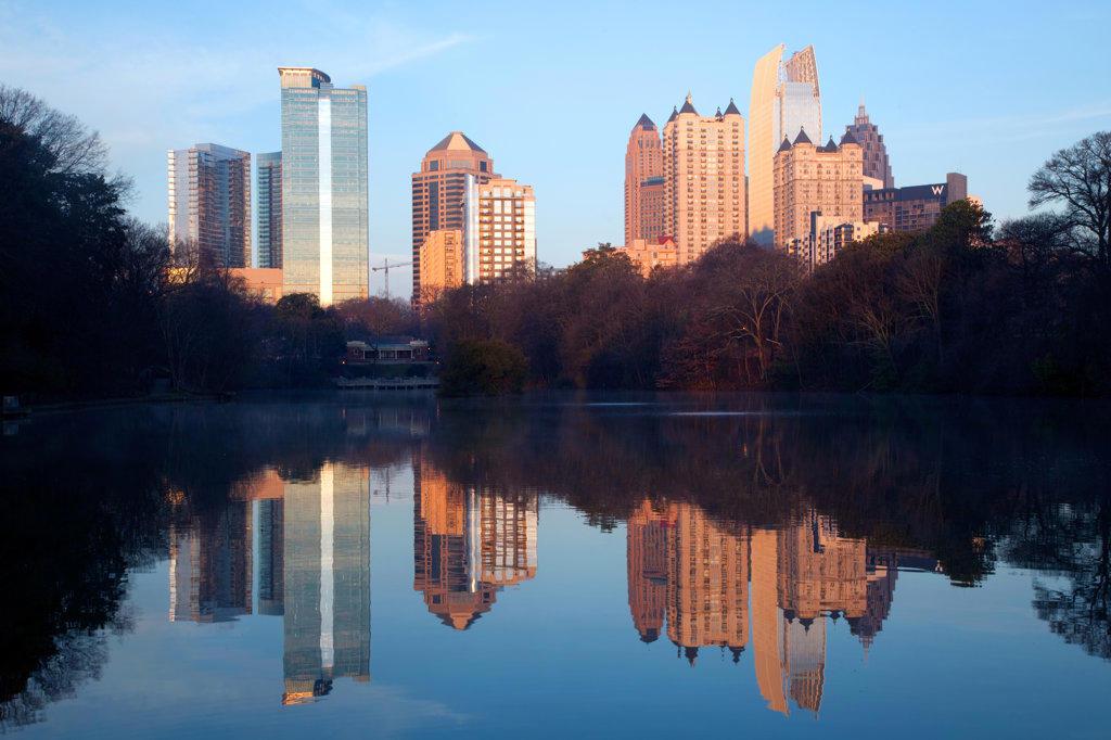 Reflection of Midtown Atlanta skyline into Lake Clara Meer in Piedmont Park, Atlanta, Georgia, USA : Stock Photo
