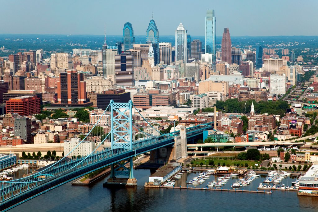 Philadelphia, Pennsylvania Skyline from over the Delaware River with the Benjamin Franklin Bridge in the Foreground : Stock Photo