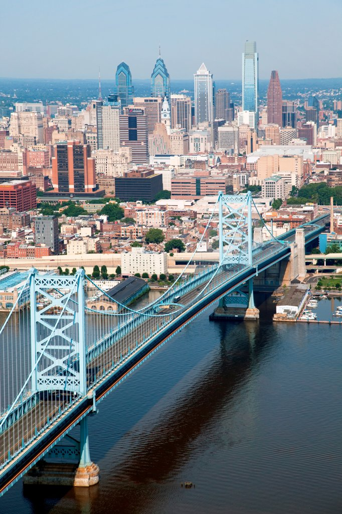 Stock Photo: 4017-3628 Philadelphia, Pennsylvania Skyline from over the Delaware River with the Benjamin Franklin Bridge in the Foreground