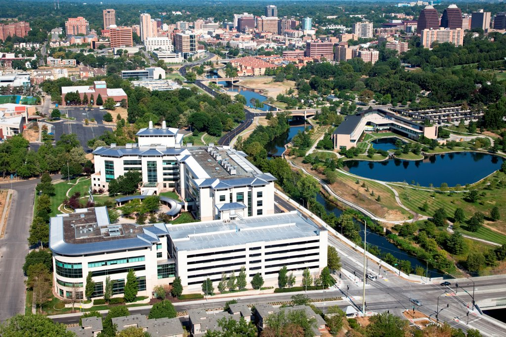 Stock Photo: 4017-3748 USA, Missouri, Kansas City, Aerial view of Stowers Institute for Medical Research campus along Brush Creek and with Plaza in distance