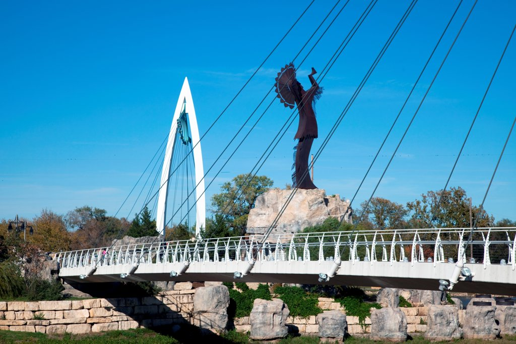 USA, Kansas, Wichita, Keeper of Plains sculpture and Arkansas River Pedestrian Bridges in Downtown : Stock Photo