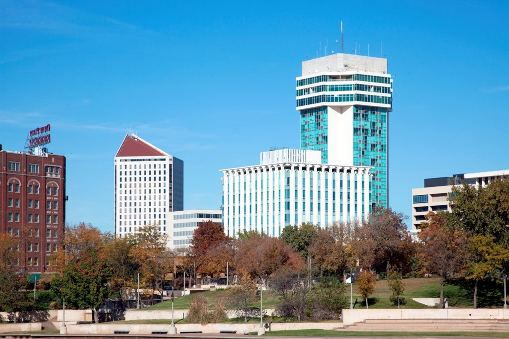 USA, Kansas, Wichita, Skyline along waterfront of Arkansas River : Stock Photo