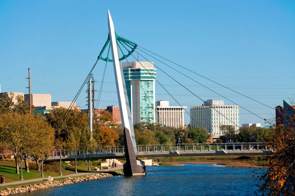 Stock Photo: 4017-3831 USA, Kansas, Wichita, Pedestrian Bridge over Arkansas River near Keeper of Plains and Downtown
