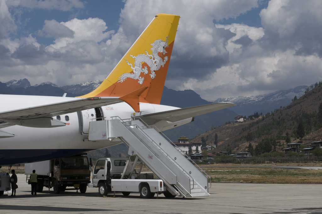 Airplane at an airport, Paro, Bhutan : Stock Photo