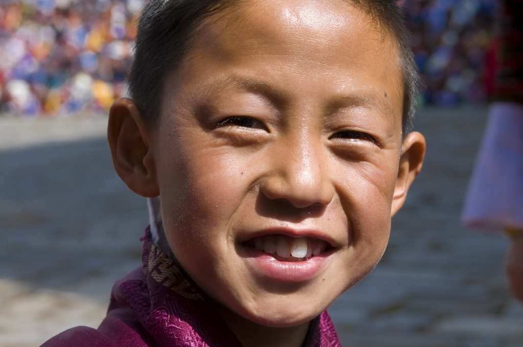 Boy enjoying in Tsechu festival, Paro, Bhutan : Stock Photo