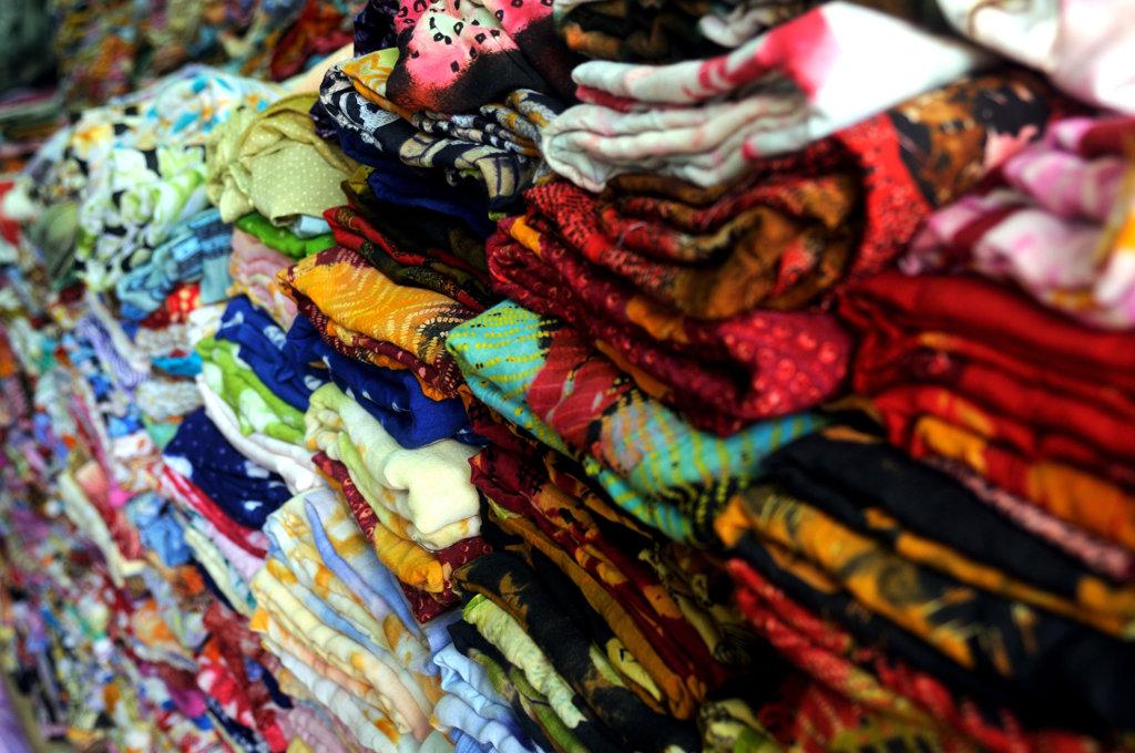 Mauritania, Nouakchott, stacked textiles : Stock Photo