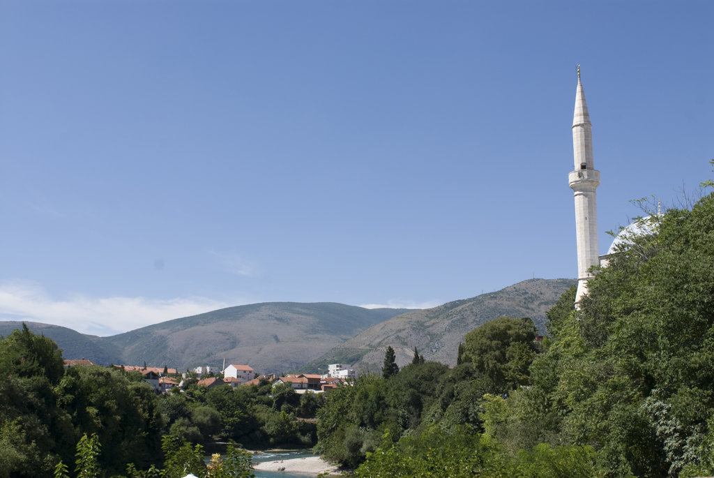 Minaret of a mosque in a city, Koski Mehmed Pasha Mosque, Mostar, Bosnia And Hercegovina : Stock Photo