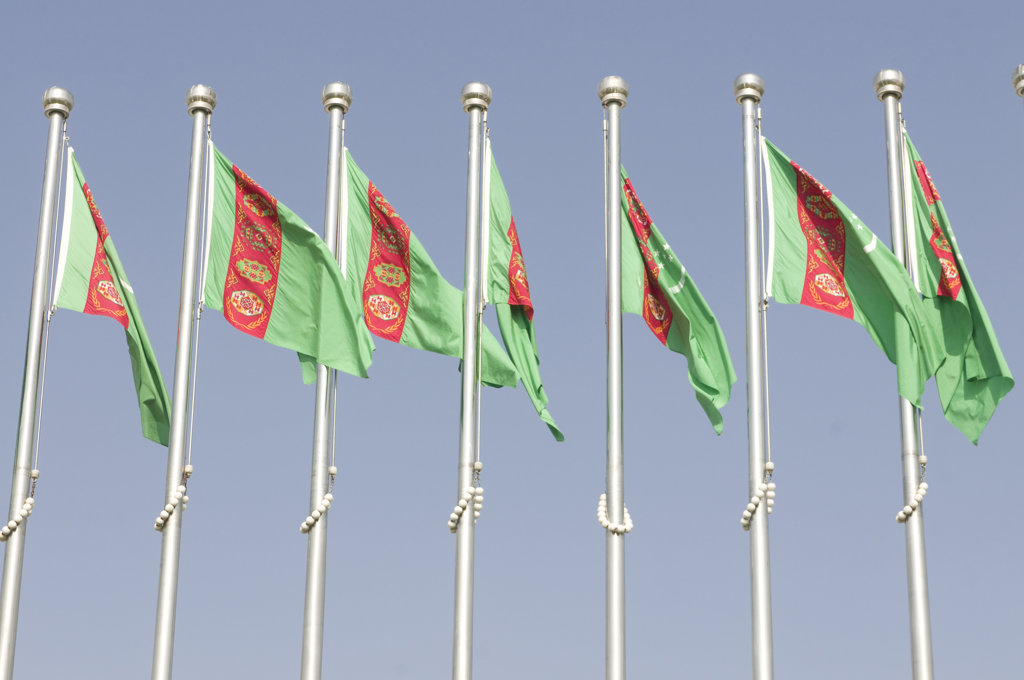 Stock Photo: 4021-2705 Turkmenistan, Ashgabad, Turkmen Flags blowing in wind