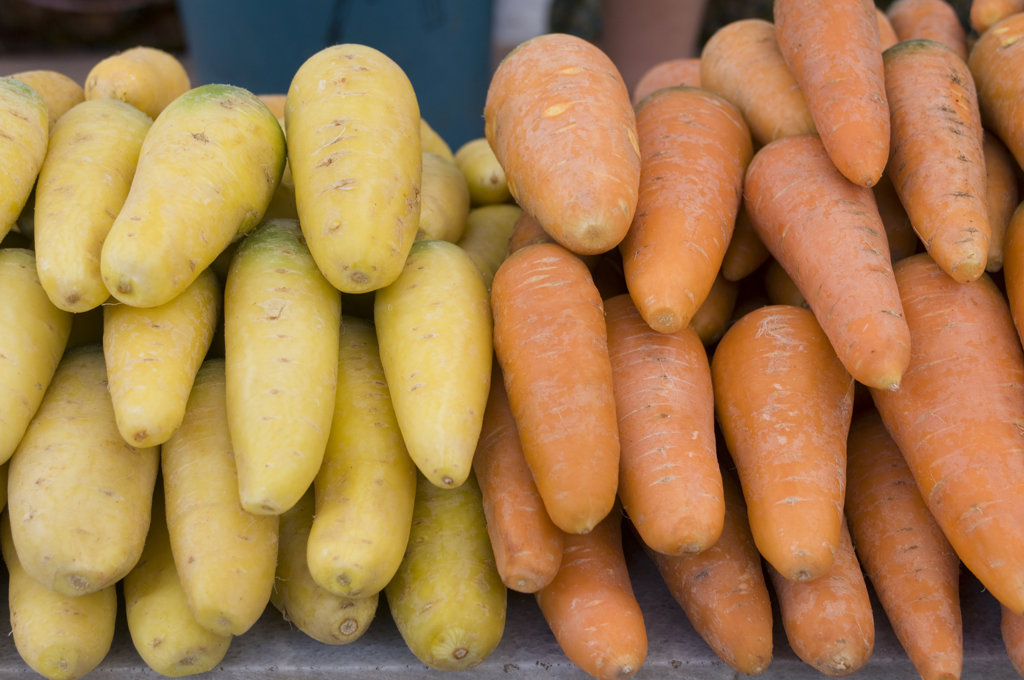 Uzbekistan, Samarqand, Fresh potatoes and carrots on local market, : Stock Photo