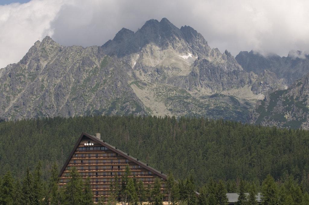 Slowakia, Hotel at Strbske Pleso lake behind high Tatras : Stock Photo