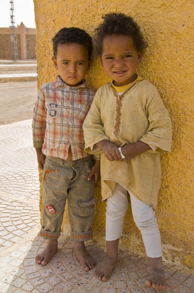 Algeria, Tadrat Tasset, Cute kids looking shy into camera : Stock Photo