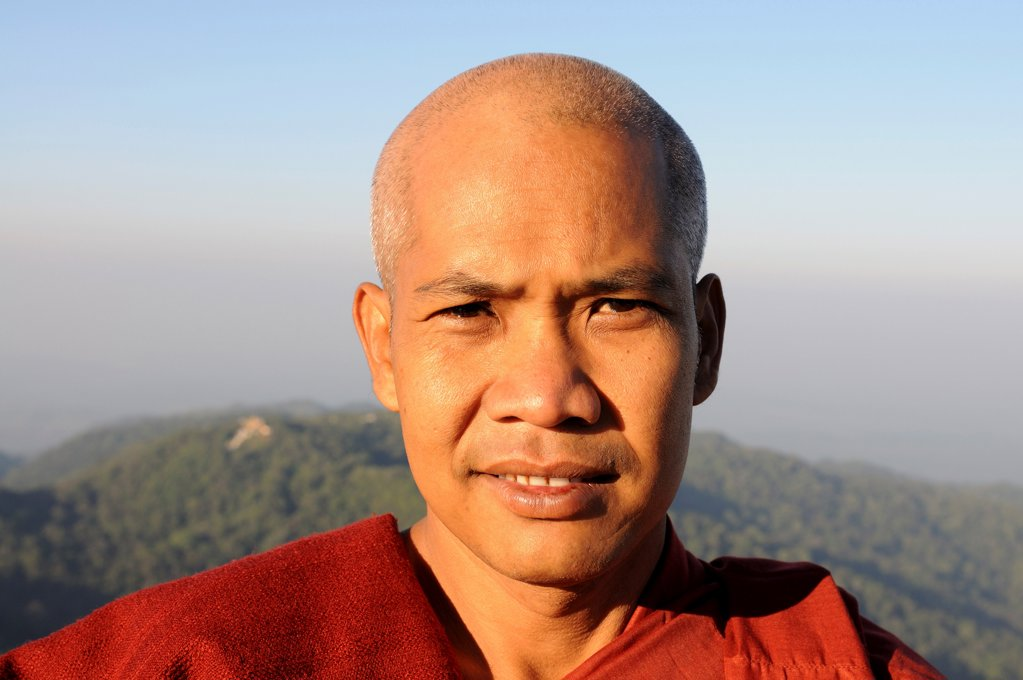 Stock Photo: 4021-4077 Portrait of a tribal pilgrim at pagoda on the golden rock, Kyaiktiyo Pagoda, Kyaikto, Mon State, Myanmar