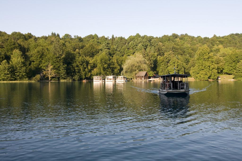 Stock Photo: 4021-691 Ferry in a lake, Plitvice Lakes, Plitvice Lakes National Park, Croatia