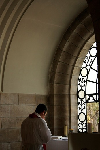 Man praying in a church, Dominus Flevit Church, Mount of Olives, Jerusalem, Israel : Stock Photo