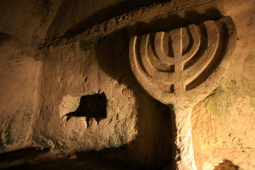 Menorah carved on stone, Cave of coffins, Beit She'arim National Park, Alonim Hills, Israel : Stock Photo