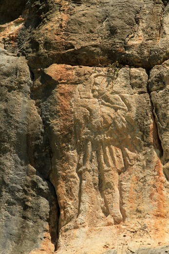 Stock Photo: 4023-312 Painting of a man engraving on cliff, Nahal Kziv, Upper Galilee, Israel