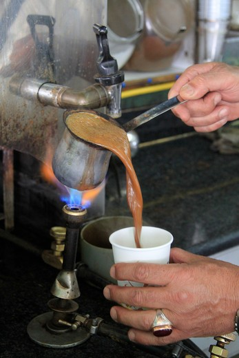 Stock Photo: 4023-498 Coffee vendor pouring coffee into a disposable cup, Jerusalem, Israel