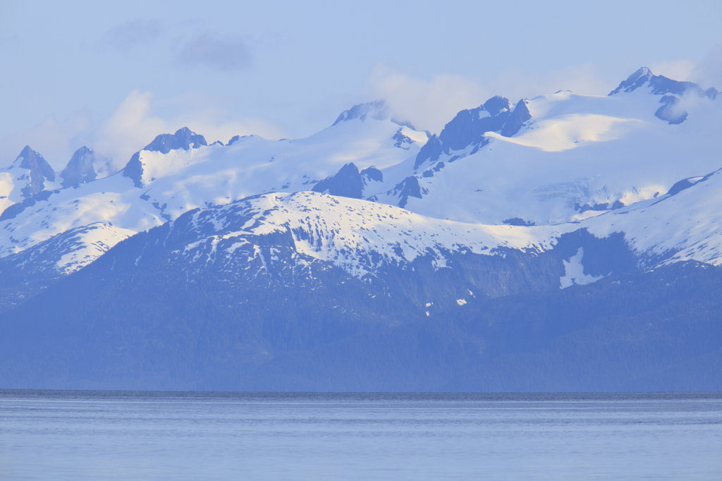 Stock Photo: 4024-158 Sea with snow covered mountains in the background, Icy Strait, Alexander Archipelago, Alaska, USA