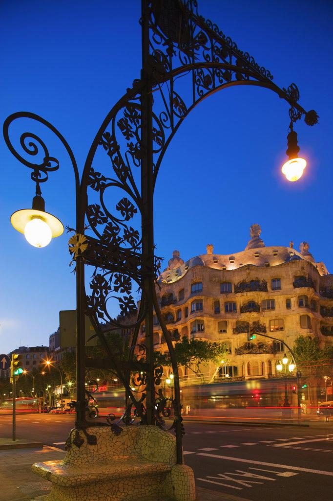 Spain, Catalonia, Barcelona, Casa Mila illuminated at dusk : Stock Photo
