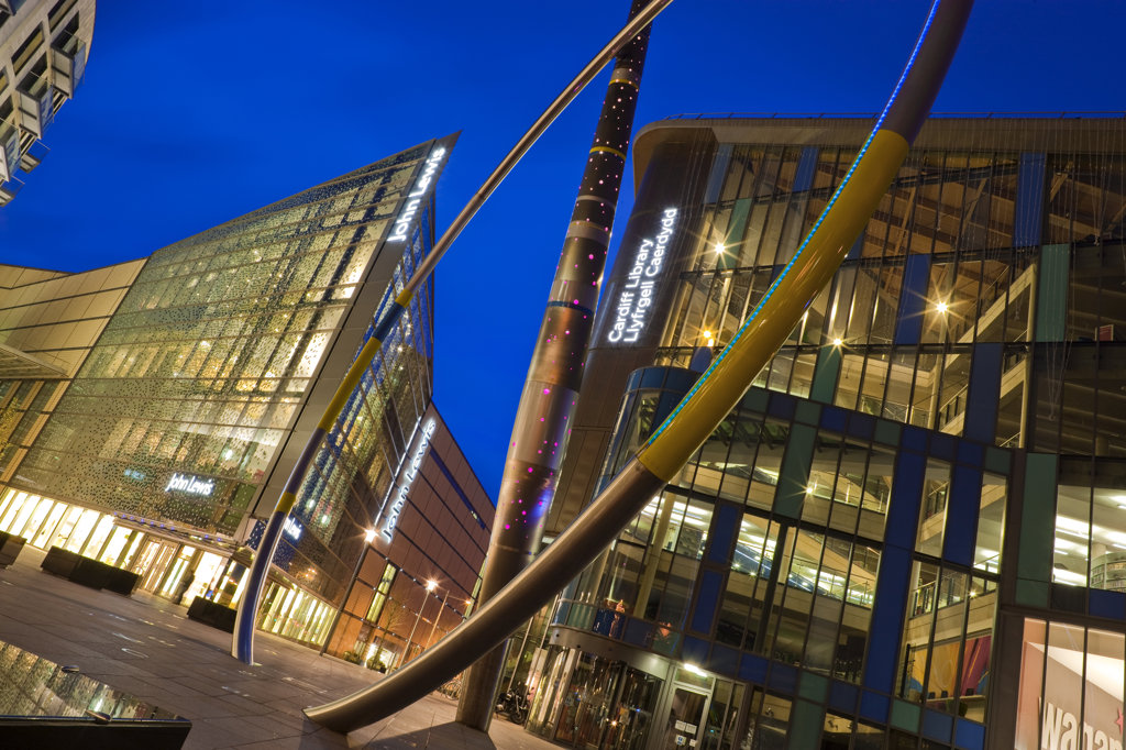 Low angle view of buildings lit up dusk, John Lewis Store, Cardiff Central Library, Cardiff, Wales : Stock Photo