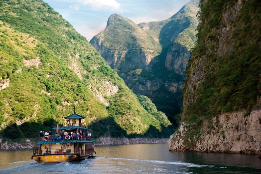 Stock Photo: 4028-1030 China, Yangtze River, A refurbished traditional river boat sails with tourists and locals down the river.