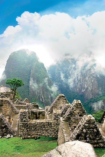 Stock Photo: 4028-1165 Peru, Machu Picchu, the ancient lost city of the Inca shrouded in mist and clouds.