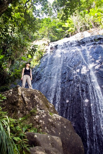 Stock Photo: 4028-1346 Puerto Rico, Luquillo, El Yunque National Forest, Woman at La Coca Waterfall.