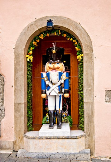 Rothenburg ob der Tauber, Germany, a life-sized nutcracker soldier on display during the Christmas holiday season in an alcove : Stock Photo