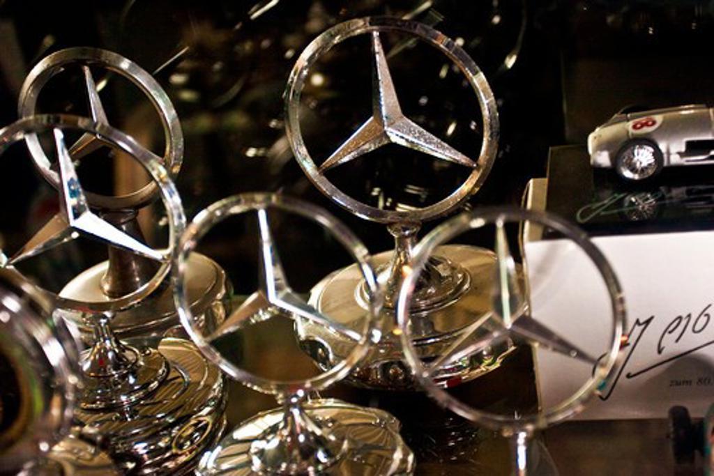 Stuttgart, Germany, Mercedes-Benz Museum, various metal mercedes hood ornaments : Stock Photo