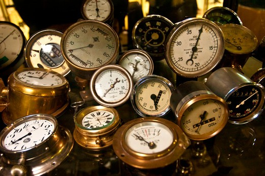 Stuttgart, Germany, Mercedes-Benz Museum, various metal mercedes speedometers, oil gages, clocks and instruments : Stock Photo
