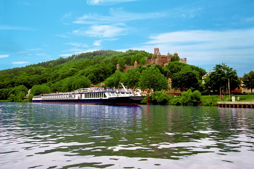 A River cruise ship docked outside of Wertheim, Germany with Wertheim Castle in the background : Stock Photo