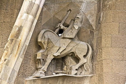 Barcelona, Catalonia, Spain, statues and stonework of  the Passion Facade of  the Temple of Sagrada Familia, by architect Josep Maria Subirachs. Longinus, the soldier who put his lance in Christ's side. : Stock Photo