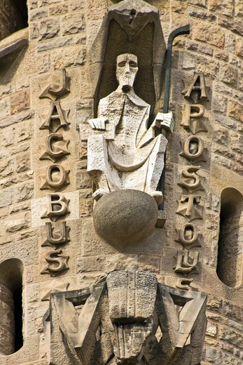 Barcelona, Catalonia, Spain, statues and stonework of  the Passion Facade of  the Temple of Sagrada Familia, by architect Josep Maria Subirachs. The apostle Jacob sits in his tower. : Stock Photo