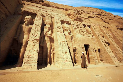 Egypt, Abu Simbel, the gate keeper stands in front of the temple of Hathor and Nefertari, also known as the Smaller Temple. : Stock Photo