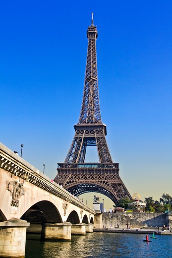 Paris, ile-de-France, France, the Eiffel Tower (Tour Eiffel) with the Pont D'Lena bridge over the Seine River : Stock Photo