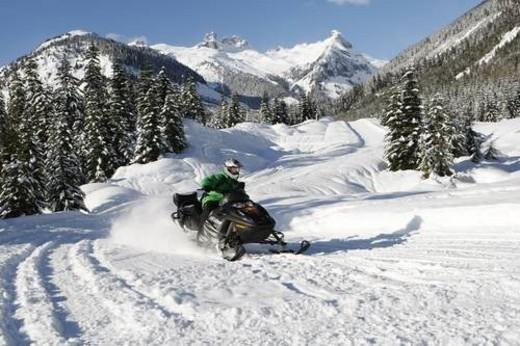 Stock Photo: 4029R-102088 snowmobile adventure tour in Whistler British Columbia