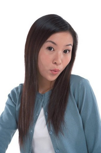 Stock Photo: 4029R-104901 Young woman looking at camera and whistling